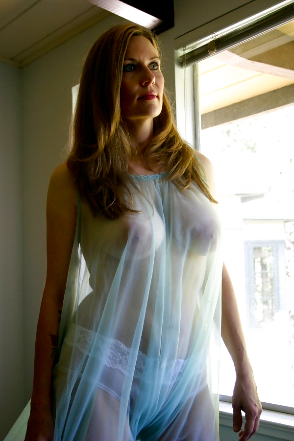 Sexy milf braless under transparent dress